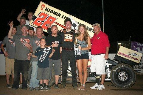 Sedalia Missouri's Jonathan Cornell is joined by friends and crew mates as he accepts his 360 Winged Sprint feature trophy from Double-X Speedway trophy girl Kassi Meisenheimer and director of competition Roy Wood.