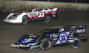Tim Manville #33 battling with Scott Bloomquist #0 during the heat race!
